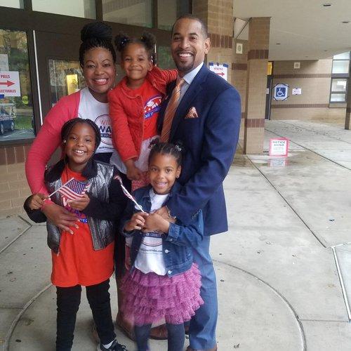 Michele Jawando with her husband, Will Jawando, and three children.